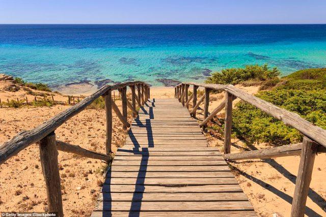 Stairway to heaven: The walkway down to the beach at Dune di Campomarino, Puglia