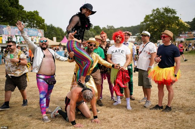 Festivalgoers dress up in bright colours for the third day of Latitude festival at Henham Park, Southwold on Saturday