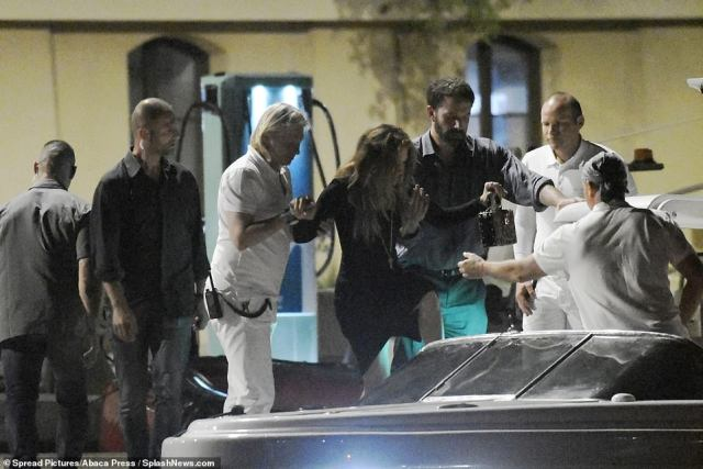 Aid: Jennifer was seen being helped onto a small boat after the couple's date