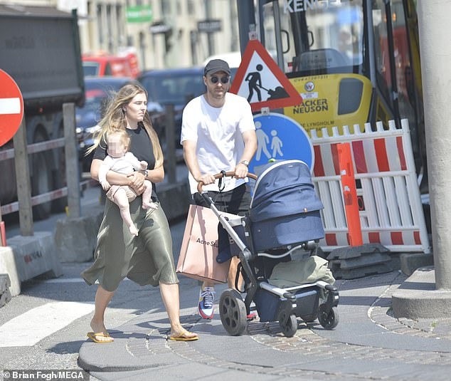 Eriksenwas yesterday spotted strolling the streets of Copenhagen with his girlfriend Sabrina Kvist Jensen and their daughter as he continues his recovery