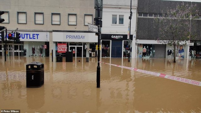 Parts of south east England saw up to 50mm of rain in just an hour on Sunday afternoon. Pictured: Wood Green high street