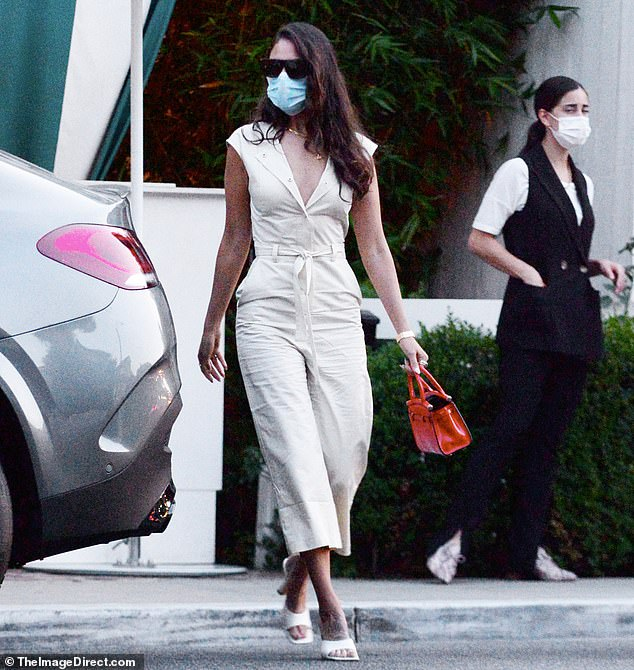Beige beauty: The 31-year-old actress wore a beige jumpsuit with matching heels as she stepped out at the private social club of San Vicente Bungalows
