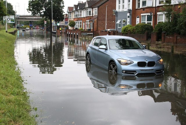The river Roding appears to have burst its banks close to the Charlie Brown roundabout below the A406 North Circular Road in South Woodford. Police have closed Chigwell Road either side of the roundabout and it remained closed overnight
