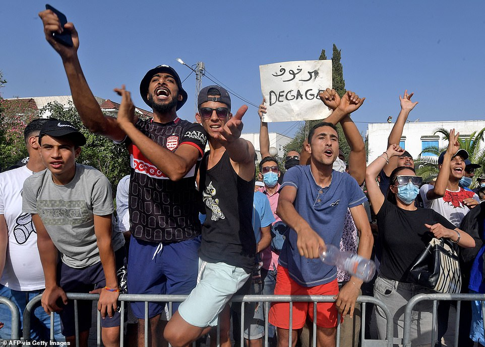 Supporters of Tunisia's President Kais Saied chant slogans denouncing the country's main Islamist Ennahda on Monday