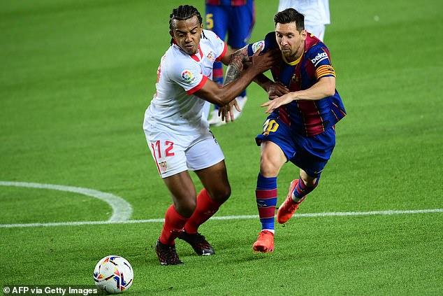 The centre-back's strength makes him a tricky opponent for many attackers, including Barcelona's Lionel Messi (both pictured in October)