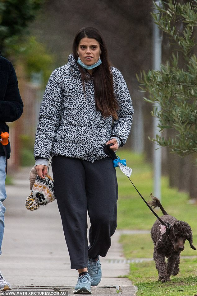 Comfort:The brunette stunner seemed less than cheerful as she took her dogs for a walk, and rugged up in a grey puffer jacket