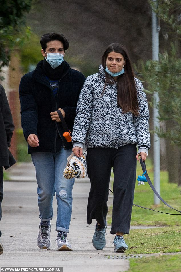 Dressed down:Brooke appeared to go makeup-free, and had on a blue surgical mask which she wore pulled down