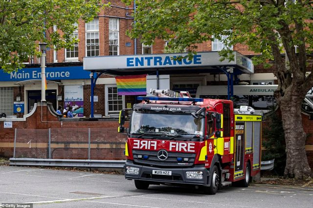 Flooding forced Whipps Cross Hospital to cancel surgeries and appointments after some departments lost power during the thunderstorms yesterday afternoon. Pictured:A fire engine is seen outside the main entrance to Whipps Cross Hospital today