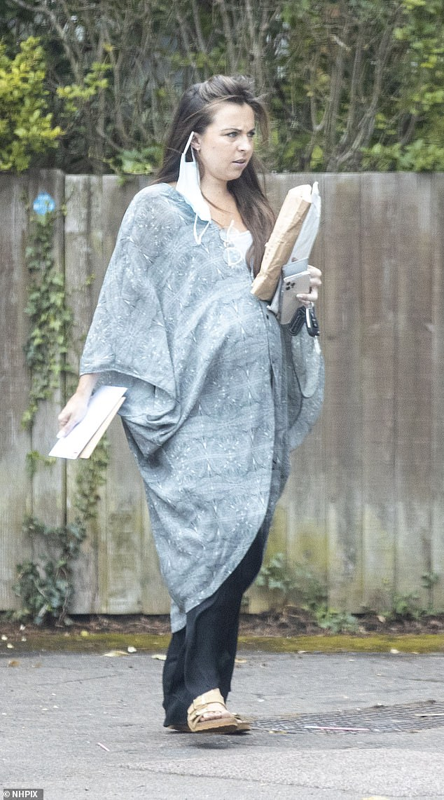 Amazing: Her brunette locks were pinned back into a loose up-do and she wore minimal make up which showcased her pregnant glow