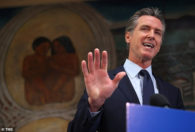 California Governor Gavin Newsom, pictured at a news conference on May 10, announced on Monday that all state and health care employees in the state would have to either get a COVID vaccination or submit to regular testing starting next month