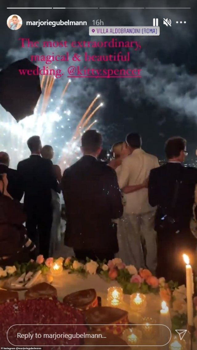 After the ceremony, the couple treated guests to a sumptuous dinner and dancing, before they took to the balcony to watch an incredible fireworks display (pictured)