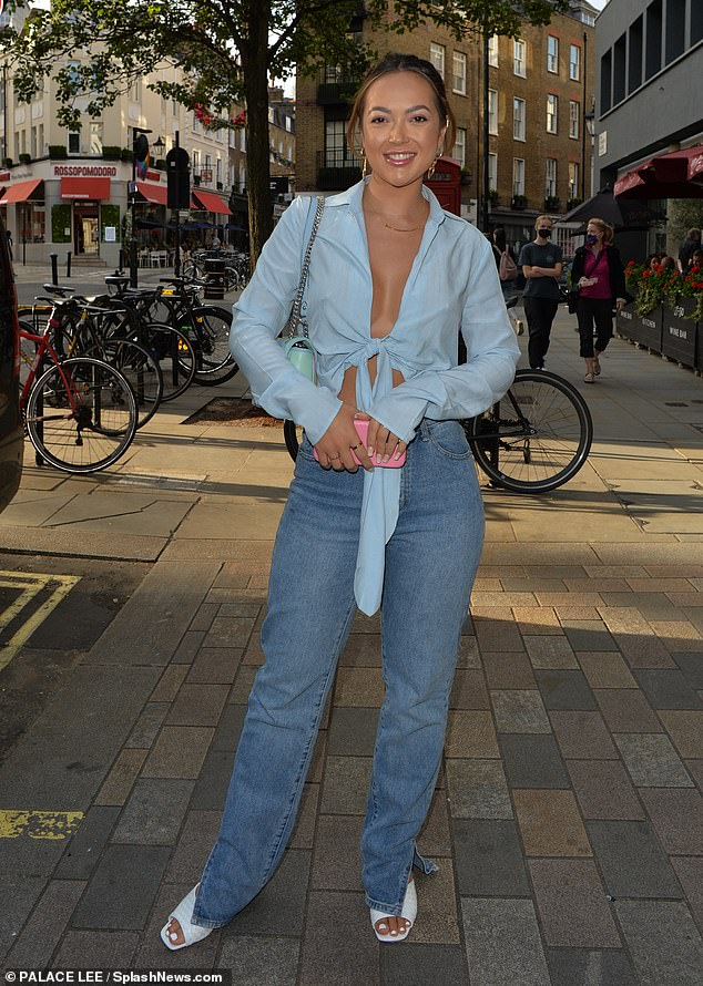She's got style: Sharon teamed the look with light wash jeans which featured a small slit at the bottom