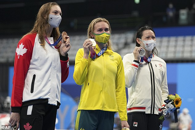 Siobhan Haughey (right) made history as she gave Australian Ariarne Titmus (centre) a run for her money before finishing second to claim silver