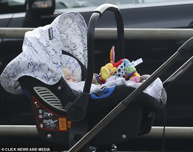 Wait patiently: adorable little Santiago waited patiently while his mother unloaded the car