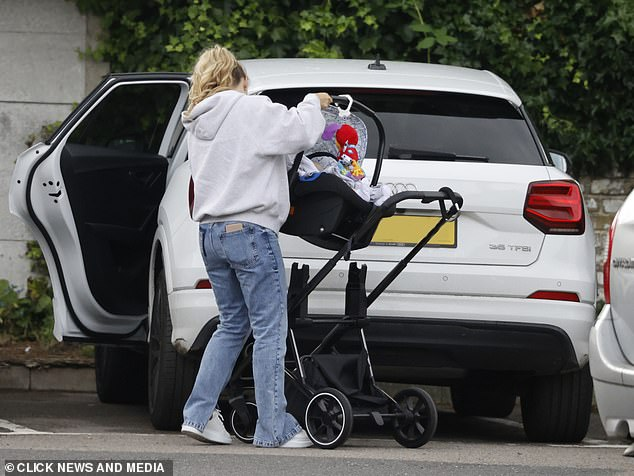 The final touch!  Dani Secured Her Baby Boy's Car Seat Safe
