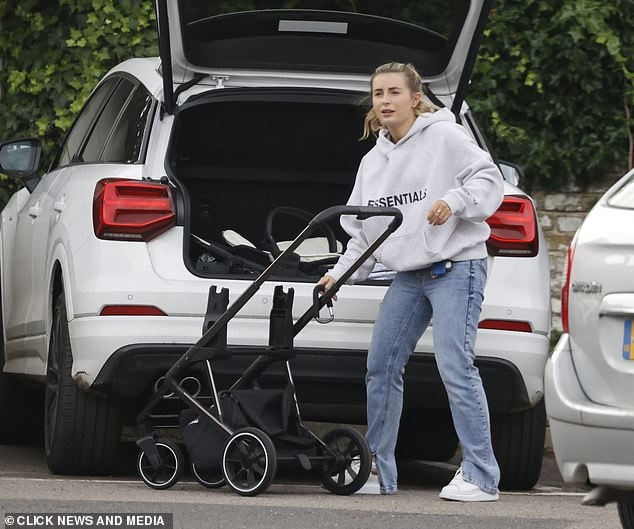 Set-up: Proving that she's become a mom like a pro, Dani has her son's stroller set up in no time