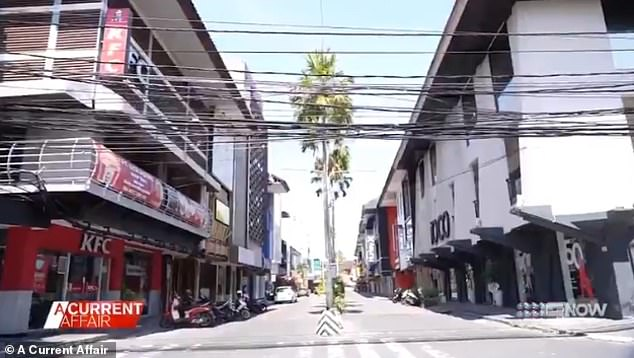 The usually bustling streets in Legian and Kuta (pictured) have become ghost towns, with case numbers and deaths rising daily