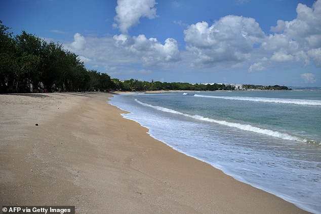 A deserted Kuta Beach on Bali is seen on July 23 (pictured) with the island's tourism-starved locals struggling to survive