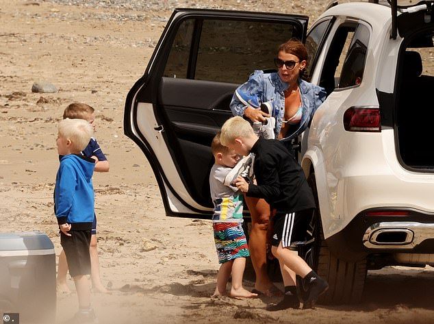Her boys: She was joined on the beach by sons Kai, 11, Klay, eight, Kit, five, and Cass, three.