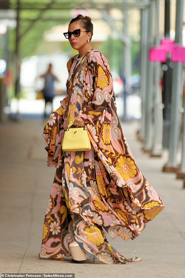 Flower power: Gaga - whose full name is Stefani Joanne Angelina Germanotta - sported a long-sleeved silk scabbard with a golden yellow and solid rose floral print