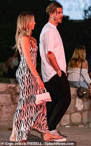 Gorgeous: Stunned blonde beauty in a zebra print maxi dress