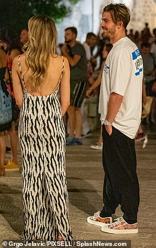 In love: The footballer is clearly in love with the blond model