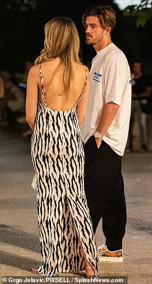 Details: her dress had a subtle cowl neck and scoop back