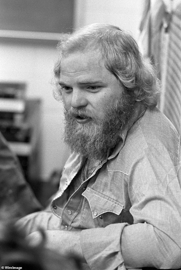 Formerly: Hill of ZZ Top relaxes in the locker room after playing at Georgia Southern College Coliseum in Statesboro, Georgia in 1973