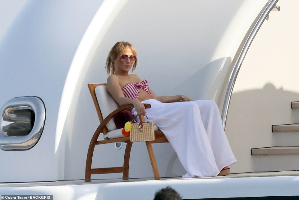 Take a break ?  Bennifer's love tour appeared to overwhelm the singer who was seen lounging in a chair while waiting to get off the ship
