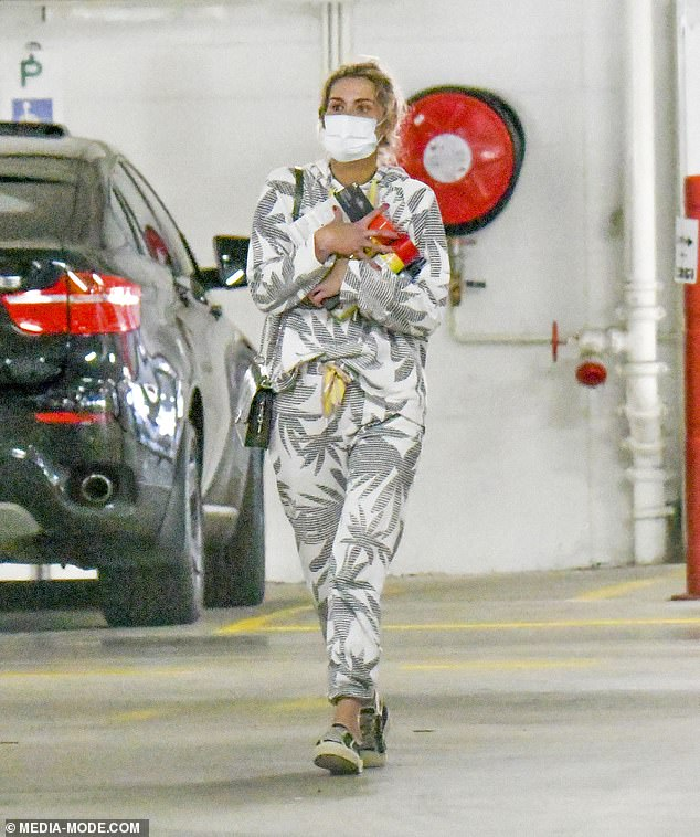 Out: On Wednesday, Cheyenne Tozzi stepped out in a palm tree print tracksuit as she picked up lockdown supplies at her local Bunnings in Sydney