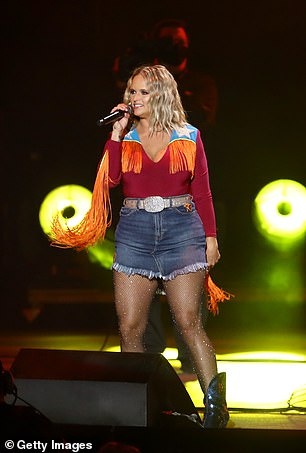 Working it: Fans rejoiced as she played songs including Gunpowder and Lead, Mama's Broke Heart, Little Red Wagon and Drunk