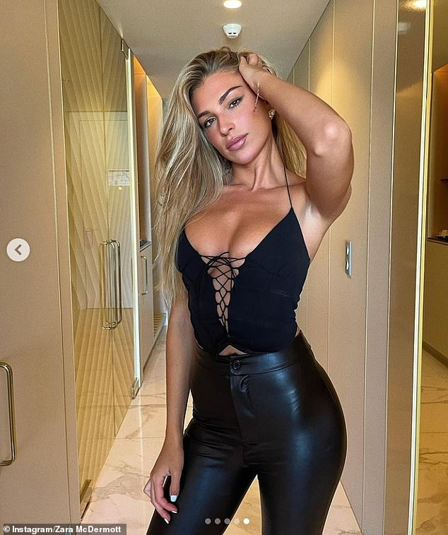 Leather look: The Love Island star, 24, flaunted her surgically enhanced neckline in a plunging black corset top, which featured a bold cut-out bust section trimmed with lace
