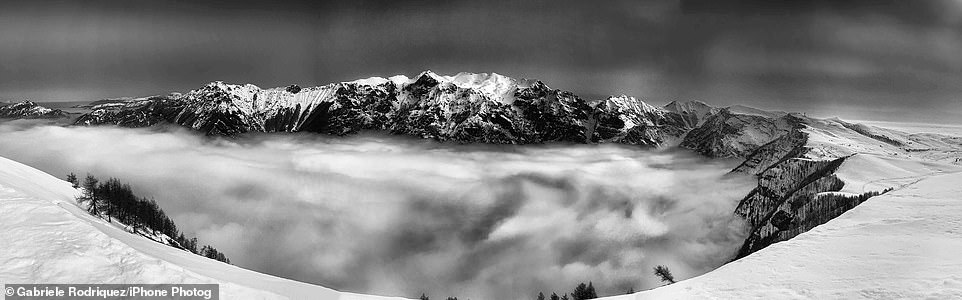 Over the Clouds: A stunning black-and-white landscape is shown in this panoramic photograph taken byGabriele Rodriquez looking across to Gruppo del Carega, Italy. The mountain has an elevation of 2,259 metres