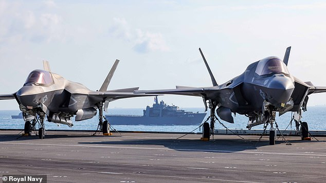 F-35 lightning stealth fighters are seen on the deck of Big Lizzie, with a warship of the Singapore navy in the background during joint drills earlier this week