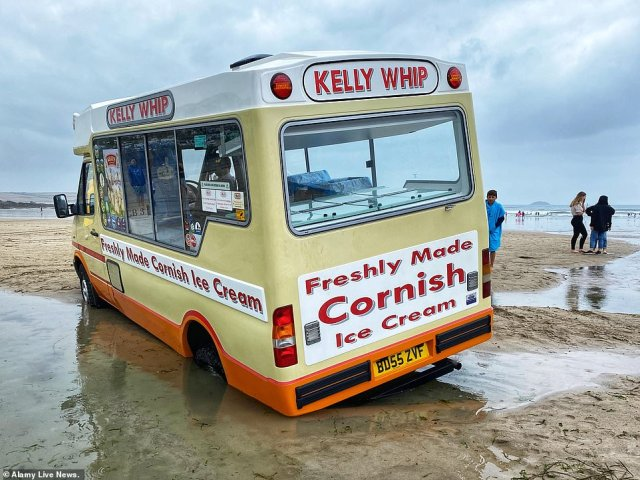 An ice cream van became stuck in the sand after the tide turned on Polzeath Beach in Devon on Thursday amid the changing conditions