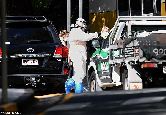 The unlinked case at Indooroopilly State High School saw the school closed for 48 hours to undertake deep cleaning (above) as contact tracers worked to find the source of the infection