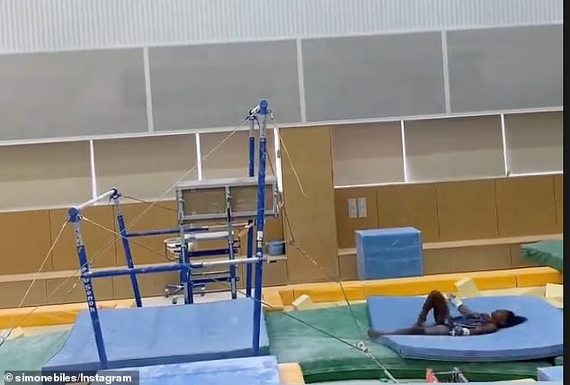 She posted video of herself landing on her back as she dismounts from the uneven bars