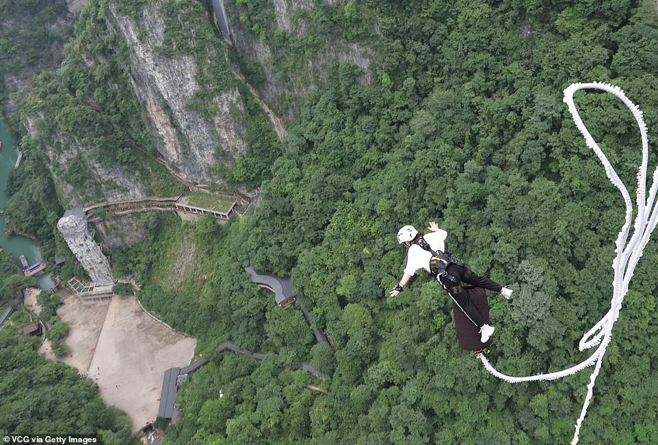A tourist takes the leap from the bungee jumping platform at the Zhangjiajie Grand Canyon in July 2021, only months after the operation opened amid the pandemic in 2020