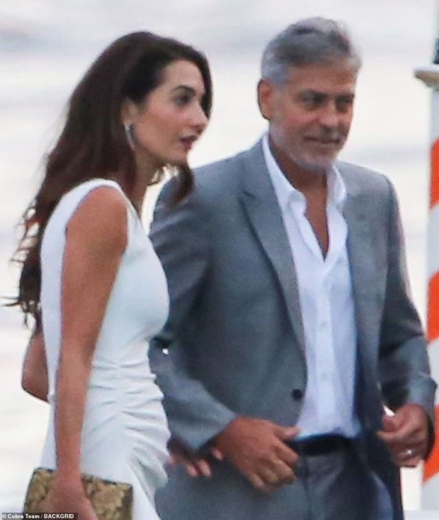 Dinner date: The couple had been pictured enjoying an evening out in Italy on July 20 in Lake Como, where Amal donned a figure-hugging white dress and George looked sharp in a grey suit