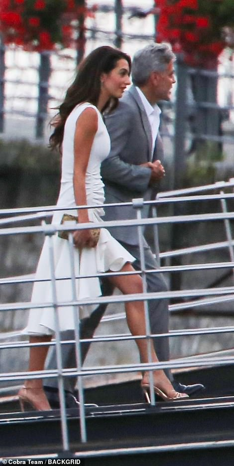 Hold me close: The couple held hands during the outing