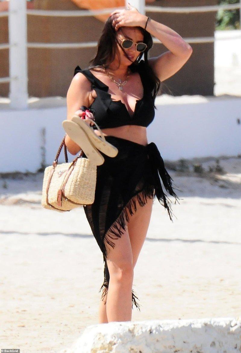 Designer diva: Jess carried her belonging in a woven Prada handbag
