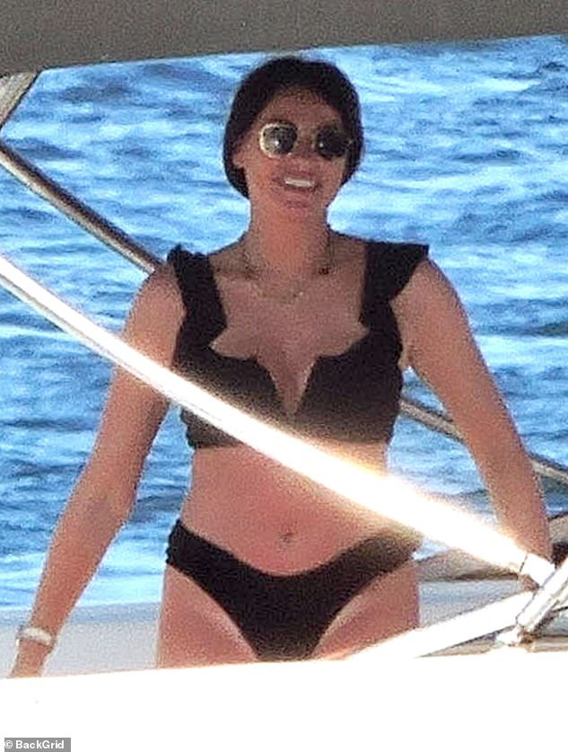 Gorgeous: Jess flashed a wide smile as she enjoyed their day at sea