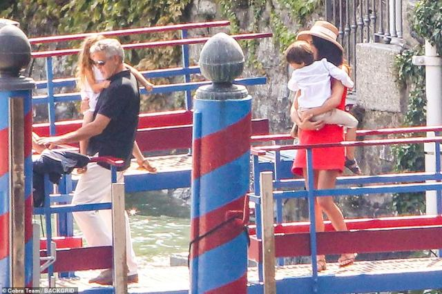Off they go: The family all coordinated in their smart ensembles and summer shoes for the lunch out in Cernobbio, Italy