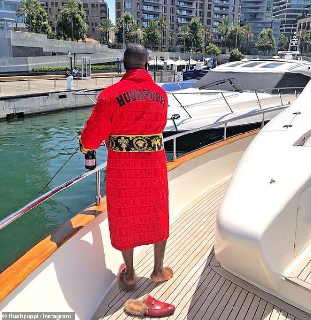 Typical Hushpuppi posts feature expensive vehicles such as boats, planes, helicopters and cars, along with designer outfits including Gucci, Yves Saint Laurent and Versace (pictured)