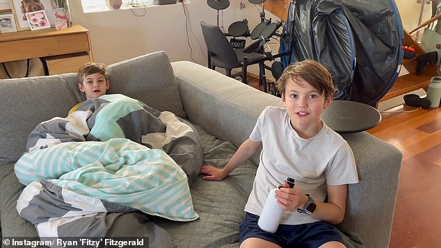 Unamused:The Nova host and former Sydney Swans player later tells his sons that the pack opening was a 'stitch up,' but Hewy and Lenny tell their father they already knew