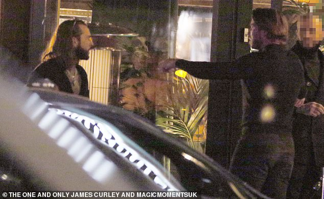 Duo: Pete was joined at the party by his pal James and the couple were also pictured doing an animated screen while talking to the doorman