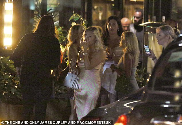 Group: The blonde, who looked stunning in a green and pink satin dress, put a hand to her face while talking with Pete after the heated conversation