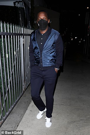 Smart: He completed his look with a pair of black and white trainers