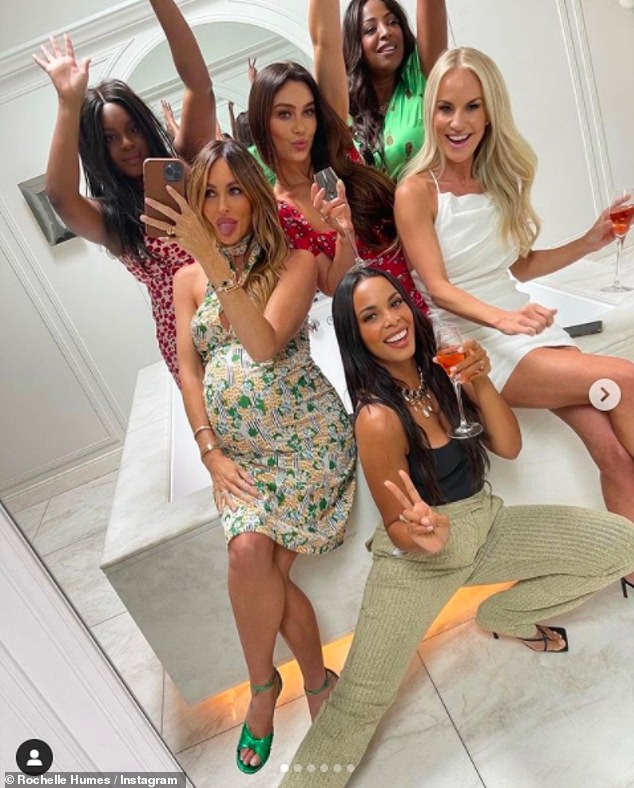 Get together: The gaggle of girls looked very glamorous as they posed in the mirror amid the festivities