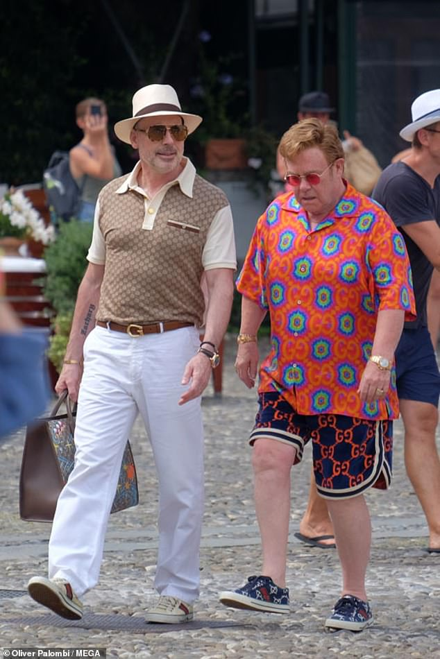 Hit the town: Sir Elton John, 74 (left) showcased his signature style in a vibrant Gucci shirt as he dated husband David Furnish, 58 (right) in Portofino on Saturday